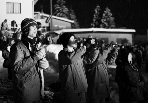 Nozawa Onsen fire festival 2013. The crowd admires the spectacle.