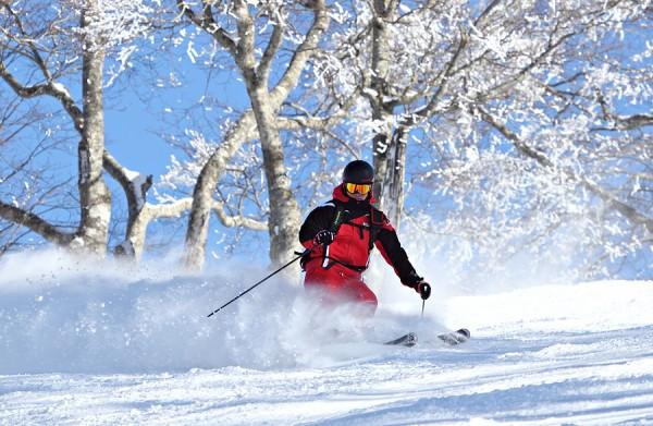 A skier enjoys a run down Yamabiko.